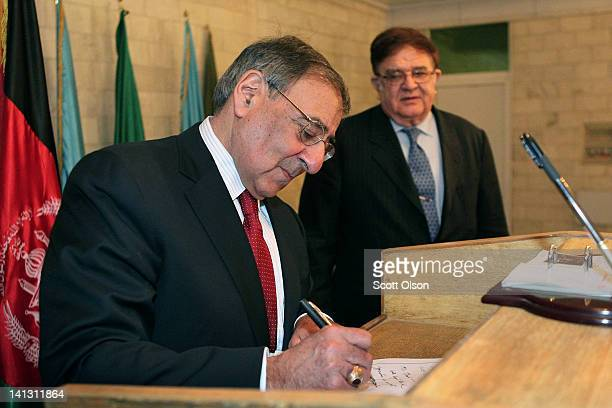 Afghanistan's Minister of Defense Abdul Rahim Wardak watches as US Secretary of Defense Leon Panetta signs a guest book prior to a meeting March 14...