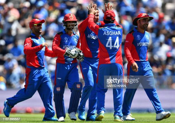 Afghanistan's Mohammad Nabi celebrates with teammates after the dismissal of India's captain Virat Kohliduring the 2019 Cricket World Cup group stage...