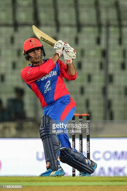 Afghanistan's Mohammad Nabi plays a shot during the second match between Afghanistan and Zimbabwe in the T20 Tri-nations cricket series at the...