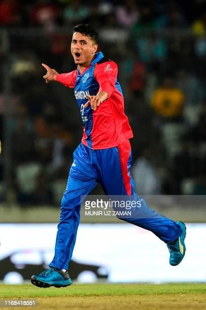 Afghanistan's Mujeeb Ur Rahman celebrates after the dsmissal of Bangladesh's Soumya Sarkar during the third match between Afghanistan and Bangladesh...