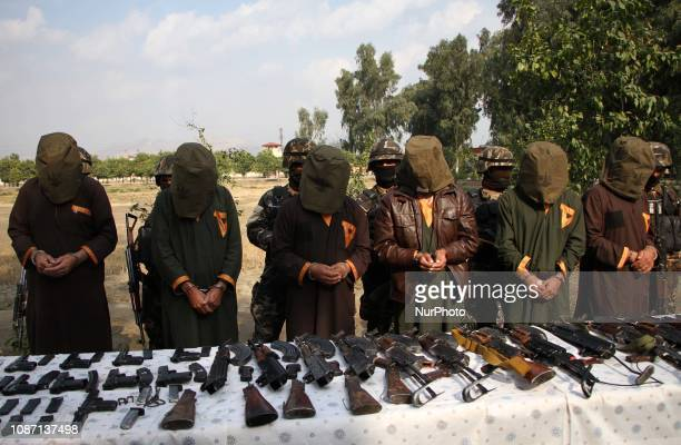 Afghanistan's National Directorate Security escort a group of suspected militants who are accused of planning attacks on government and security...