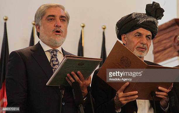 Afghanistan's new President Ashraf Ghani Ahmadzai and Afghanistan's Chief Executive Abdullah Abdullah take the oath during their inauguration in...