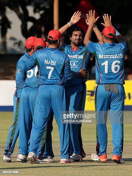 Afghanistan's palyers celebrate a wicket during the fifth and final One Day International cricket match between Afghanistan and Zimbabwe at the...
