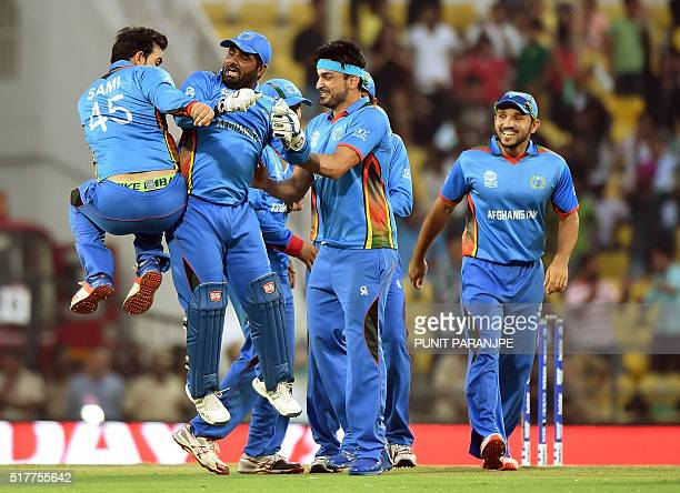 Afghanistan's players celebrate after the wicket of West Indies's batsman Andre Russell during the World T20 cricket tournament match between West...