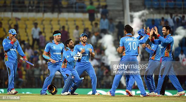 Afghanistan's players celebrate after winning the World T20 cricket tournament match against West Indies at The Vidarbha Cricket Association Stadium...