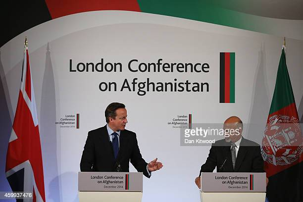 Afghanistan's President Ashraf Ghani and British Prime Minister David Cameron speak to members of the media during the London Conference on...