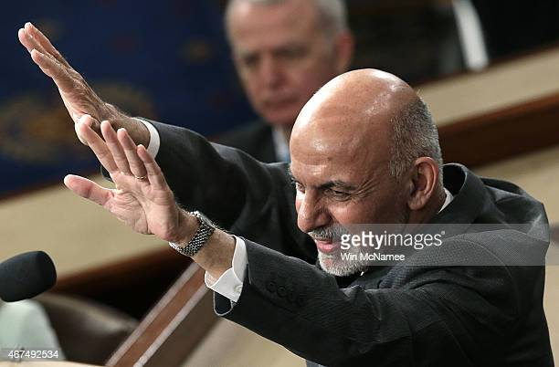 Afghanistan's President Ashraf Ghani reacts to a standing ovation at the conclusion of his address to a joint meeting of the US Congress March 25...
