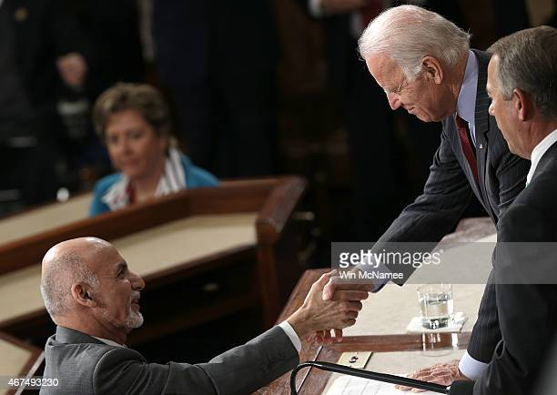 Afghanistan's President Ashraf Ghani shakes hands with US Vice President Joe Biden and Speaker of the House John Boehner after delivering an address...