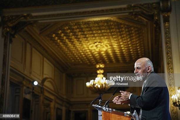 Afghanistan's President Ashraf Ghani speaks to delegates and ministers during the London Conference on Afghanistan in central London on December 4,...
