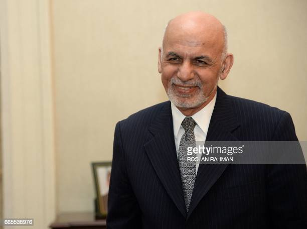 Afghanistan's President Ashraf Ghani waits for Singapore's Prime Minister Lee Hsien Loong at Istana presidential palace in Singapore on April 7 2017...