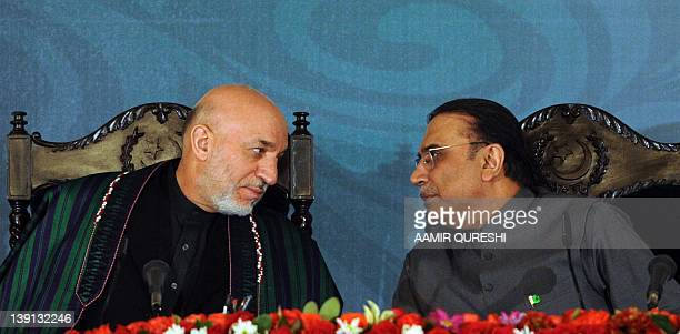 Afghanistan's President Hamid Karzai and Pakistan's President Asif Ali Zardari speak during a joint press conference with Iranian counterpart Mahmoud...