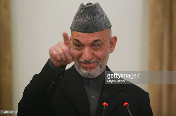 Afghanistan's President Hamid Karzai attends a joint press conference with Belgian Prime Minister Yves Leterme on December 20, 2009 in Kabul,...