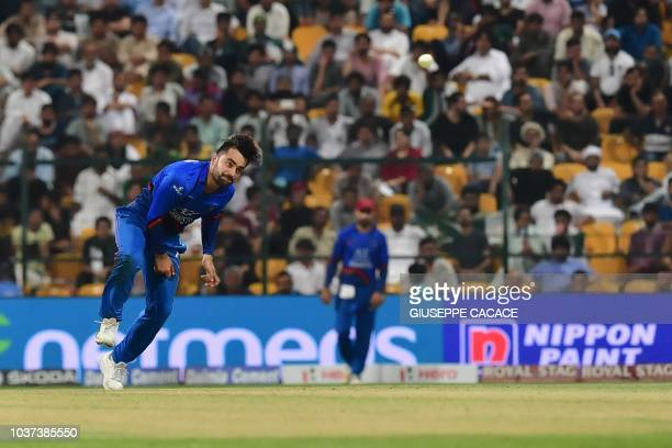 Afghanistan's Rashid Khan bowls during the one day international Asia Cup cricket match between Pakistan and Afghanistan at The Sheikh Zayed Stadium...