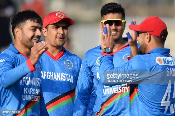Afghanistan's Rashid Khan celebrates after dismissing Ireland's Andrew Balbirnie during the second T20 cricket match between Afghanistan and Ireland...