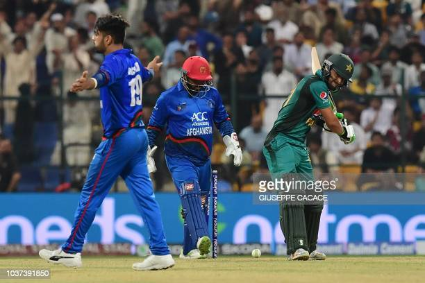 Afghanistan's Rashid Khan celebrates after he dismiss Pakistan's Mohammad Nawaz during the one day international Asia Cup cricket match between...