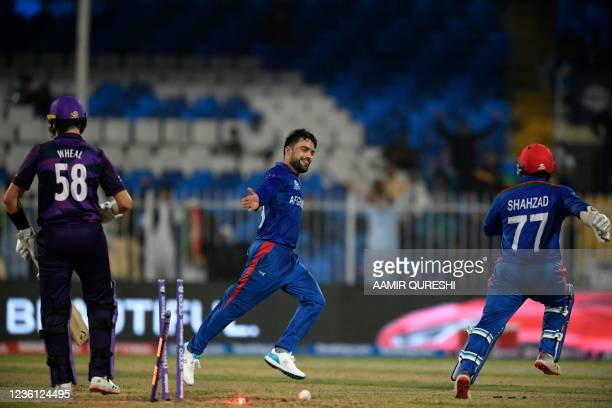 Afghanistan's Rashid Khan celebrates after taking the wicket of Scotland's Brad Wheal during the ICC mens Twenty20 World Cup cricket match between...