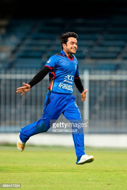 Afghanistan's Rashid Khan celebrates the wicket of Ireland's Niall O'Brien during the third one day international cricket match between Afghanistan...