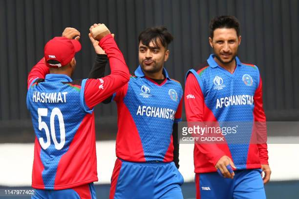 Afghanistan's Rashid Khan celebrates with teammates after bowling Sri Lanka's Nuwan Pradeep for a duck during the 2019 Cricket World Cup group stage...