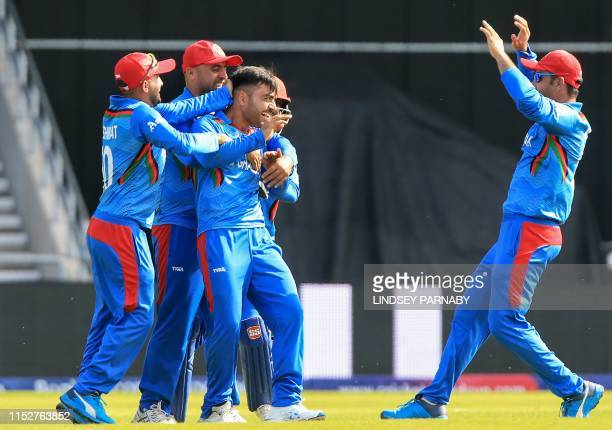 Afghanistan's Rashid Khan celebrates with teammates after hid dismissal of Pakistan's Haris Sohail during the 2019 Cricket World Cup group stage...