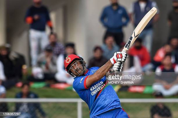 Afghanistan's team captain Asghar Afghan plays a shot during the third T20 between Afghanistan and Ireland in Greater Noida on March 10, 2020.