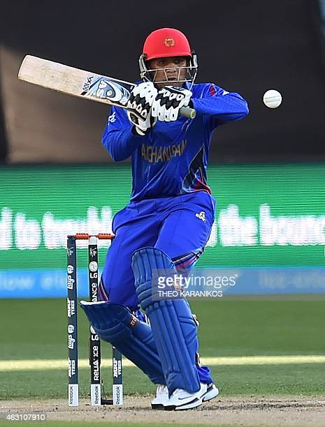 Afghanistan's Usman Ghani plays a shot from the bowling of India's Mohit Sharma during the oneday international warmup cricket match between India...