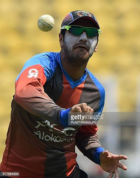 Afghanistan's Usman Ghani throws a ball as he takes part in a training session at The Vidarbha Cricket Association Stadium in Nagpur on March 26 2016...