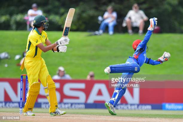 Afghanistan's wicketkeeper Ikram Ali Khil attempts to catch a ball off Australia's captain Jason Sangha during the U19 semifinal cricket World Cup...