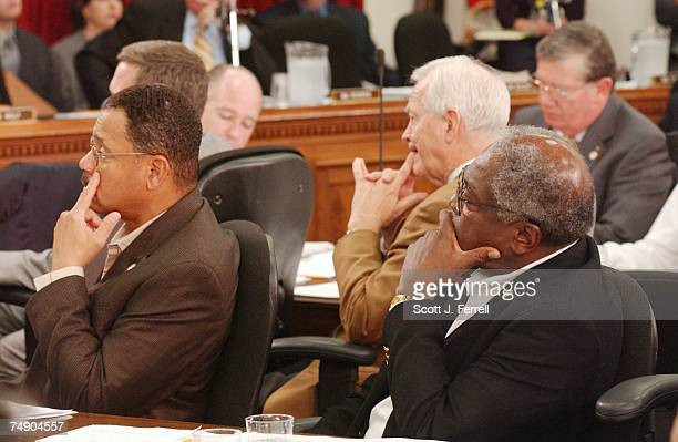 AFGHANISTANSanford D Bishop Jr DGa Joe Knollenberg RMich background and James E Clyburn DSC listen to John P Murtha DPa give a statement during the...
