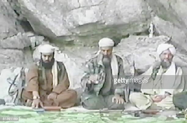 Saudiborn millionaire Osama bin Laden appears with alQaeda spokesman Suleiman Abu Ghaith and Ayman alZawahri the head of a wing of Egypt's Jihad in...