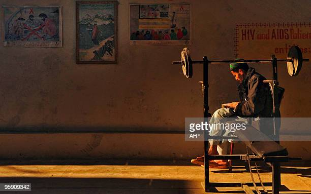 AfghanistanunrestdrugsFEATURE by Mohammad Yaqob In this file picture taken on December 23 a recovering Afghan drug addict reads a book as he sits on...