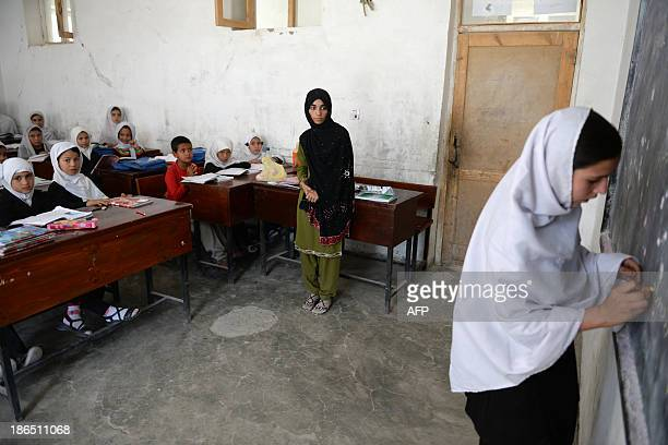 AfghanistanunresteducationchildrenFEATURE by Ben Sheppard In this picture taken on September 25 Shamsia Husseini looks on as one of her students...