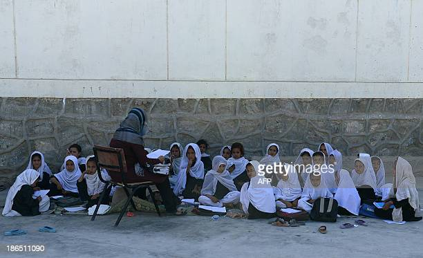 AfghanistanunresteducationchildrenFEATURE by Ben Sheppard In this picture taken on September 25 schoolgirls attend an outside classroon in Mirwais...