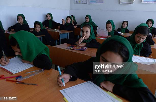 AfghanistanunresteducationwomenschoolFOCUS by Edouard GUIHAIRE In this picture taken on July 8 Afghan schoolgirls study during a lesson in the...