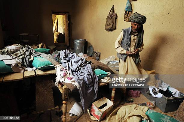 STORY 'Afghanistanunrestethnicland' by Thibauld Malterre An Afghan man of Hazara ethnicity walks inside his house believed to have been destroyed by...
