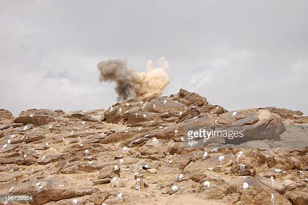AfghanistanunrestlandminesdogsFEATURE by Emal Haidary This photo taken on September 13 2012 shows smoke rising after a controlled landmine explosion...