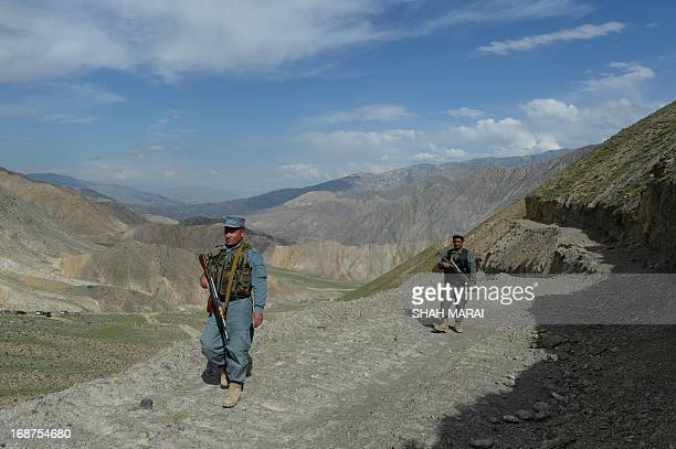 Afghanistanunrestmininggold FEATURE by Ben Sheppard Afghan policemen keep watch as miners work at the gold mine in a mountainside in the village of...