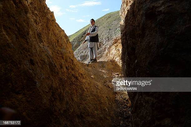 Afghanistanunrestmininggold FEATURE by Ben Sheppard In this photograph taken on May 7 Afghan miner Morad Ali walks on a mountainside near the village...