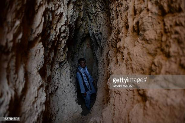 Afghanistanunrestmininggold FEATURE by Ben Sheppard In this photograph taken on May 7 Afghan miner Morad Ali stands where he was searching for gold...