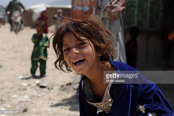 AfghanistanunrestNATOciviliansFOCUS by Lawrence Bartlett This photo taken on May 21 2012 shows an internally displaced girl from Helmand province...