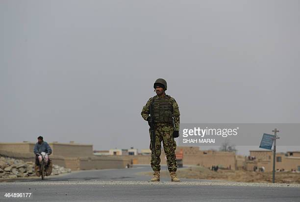 Afghanistan-unrest-NATO,FOCUS by Ben Sheppard In this photograph taken on January 23 an Afghan National Army soldier stands guard outside Bagram...