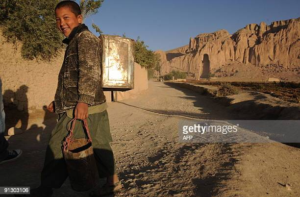 AfghanistanunrestNZealandmilitarydevelopmentFOCUS by Lynne O'Donnell This photograph taken on September 25 a Hazara youth walks in front of the...