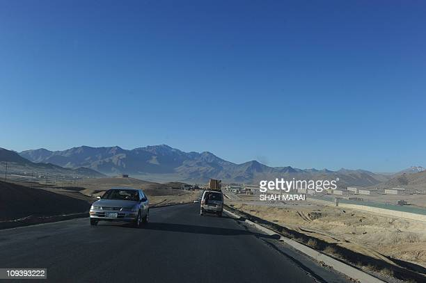 AfghanistanunrestTalibanFOCUSby Emmanuel DuparcqIn this picture taken on December 2 shows vehicles driving on the outskirts of the city of Maydan...