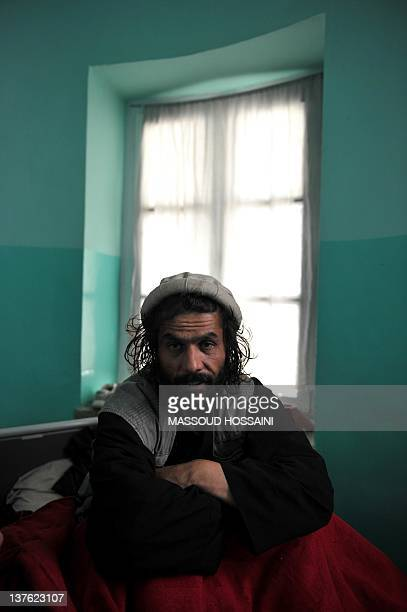 STORY 'AfghanistanunresttraumahealthFEATURE' by Mushtaq Mojaddidi In this picture taken on December 20 2011 an Afghan man waits to receive treatment...