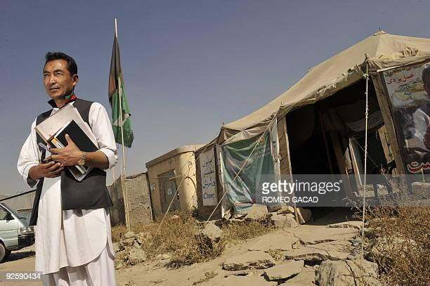 Afghanistanunrestvote by Sardar Ahmad Afghan lawmaker Ramazan Bashardost stands in front of the tent that serves as his headquarters across from the...