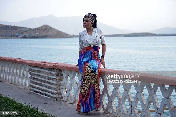 AfghanistanunrestwomencultureFEATURE by Edouard GUIHAIRE In this photograph taken on July 12 Afghan female singer Aryana Sayeed poses at Qargha lake...