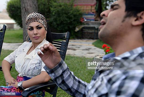 AfghanistanunrestwomencultureFEATURE by Edouard GUIHAIRE In this photograph taken on July 12 Afghan female singer Aryana Sayeed listens to a...