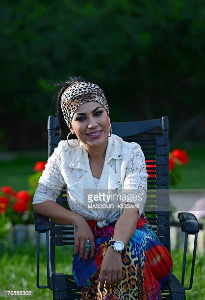 AfghanistanunrestwomencultureFEATURE by Edouard GUIHAIRE In this photograph taken on July 12 Afghan female singer Aryana Sayeed listens to...