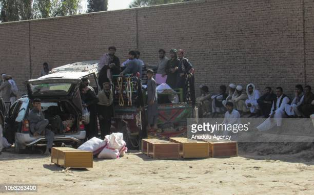 Afghans are gathered after 17 civilians were allegedly killed during an Afghan security forces operation targeting terrorist organizations in Rodat...