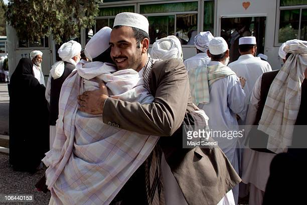 Afghans bid farewell as relatives and friends prepare to leave on a pilgrimage to the Islamic Hajj in Mecca on November 2, 2010 in Herat,...