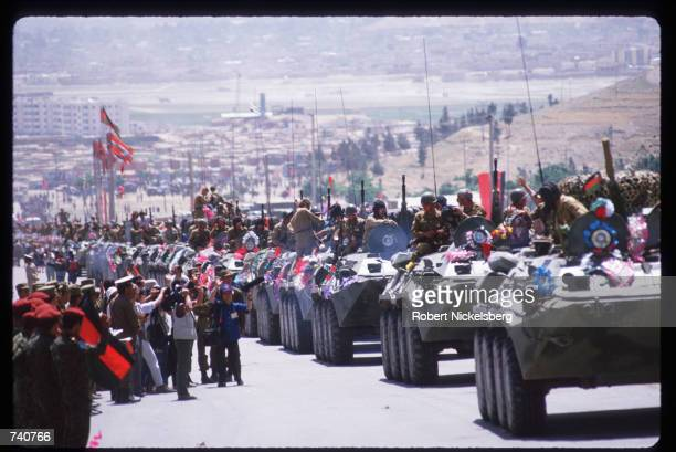 Afghans cheer as Soviet troops leave May 15, 1988 in Kabul, Afghanistan. In May 1988 Afghanistan, Pakistan, the USSR, and the United States signed...